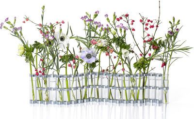 """""""Farandole of flowers, the April vase is constituted of twenty-one glass tubes and of twenty metallic similar pieces that assemble themselves. These can turn the a by report to the others, you can thus dispose his vase in accordion or in all the wished po"""