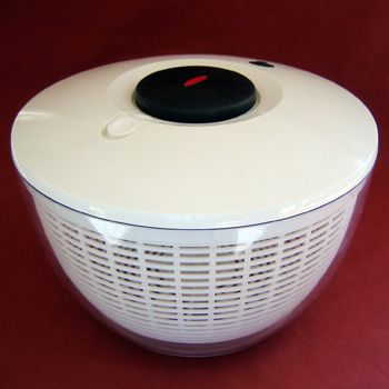 A Salad Spinner is a kitchen tool for removing excess water from salad greens.