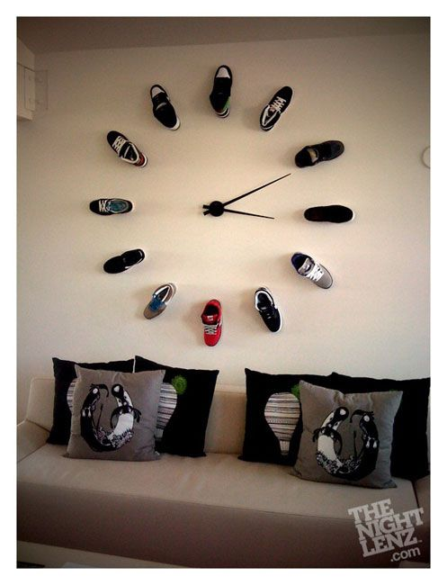 Something for Chris to do with ALL of his shoes. May take a couple walls - notice they are all lefts? shoe wall clock. something to do with my shoes during my free time.