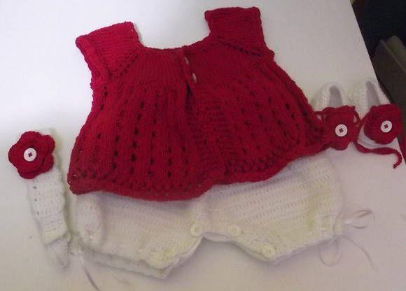 Conjunto confeccionado em fio importado próprio para bebê.  Composição do conjunto - bata ( fio importado 50% algodão e 50% bambu), fio nobre super macio ao toque, shorts ( fio em acrilico importado da Turquia), sapatinhos e tiara. detalhes - fitas, botões forrados, botões e flores de crochê. cor - vermelho e branco ( consulte sobre outras cores) tamanhos - 0 a 3 / 3 a 6 / 6 a 9 meses ( para outros tamanhos consulte). frete por conta do comprador, R$ 159,90