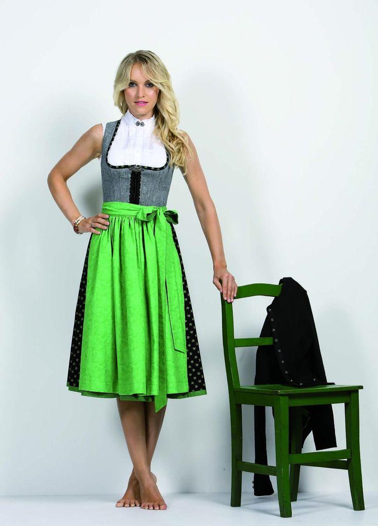 Traumhaftes Dirndl von Anno Domini Design aus grauem Leinen, schwarz geblümter Baumwolle und apfelgrüner Schürze.