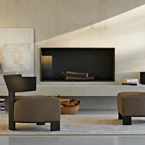 Designed by Molteni Design Team Materials: Available in a variety of fabrics and leathers Made in Italy Echoes of modernism for this small armchair marked by th