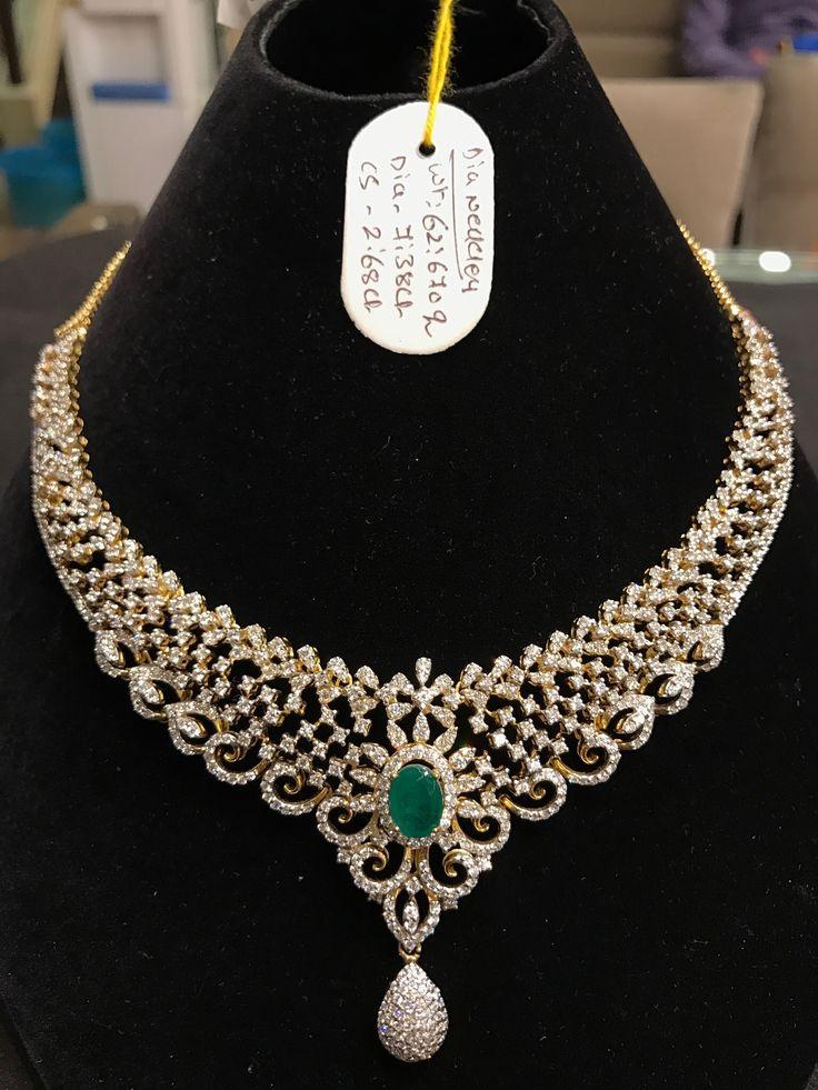 Beautiful diamond necklace with emerald gem