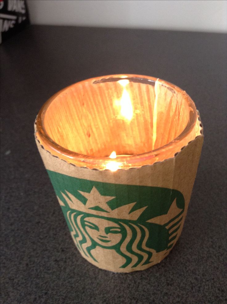 HERE A IDEA FOR YOUR ROOM DECOR!  ~STARBUCKS THEMED CANDLE~  EQUIPMENTS: - 1 Starbucks coffee sleeve  - 1 shot glassed cup - candle from your own choice (Mine is passion fruit).  - glue (super glue or fabric glue). -scissors    That's it!!❤️  Instructions: 1- measure the Starbucks coffee sleeve around the shots glass.   2- then use the scissors to cut off the extra bits of selves, so it the sleeve can fit the cup.  3- using the super glue/fabric glue, apply it on the rough side of the…