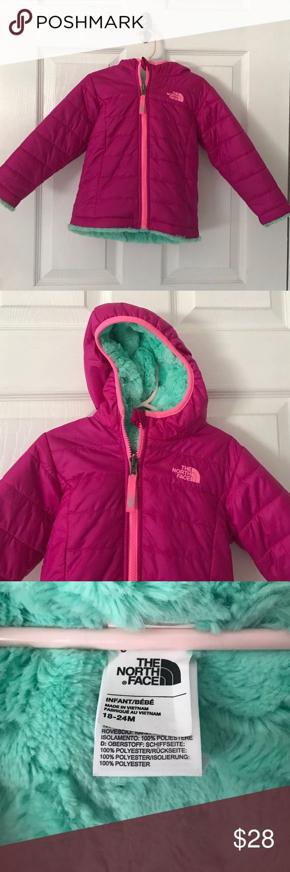 The North Face reversible winter coat Infant girls reversible winter coat. Berry pink and sea foam green. Super warm and extremely cute! I would say this runs big. The North Face Jackets & Coats