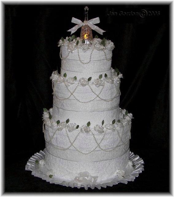101 best wedding towel cakes images on pinterest wedding towel cakes napkins and weddings. Black Bedroom Furniture Sets. Home Design Ideas