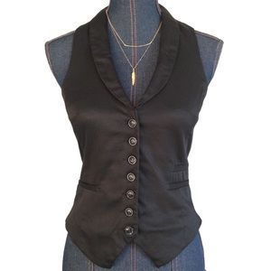 I just added this to my closet on Poshmark: H&M Tuxedo Vest. Price: $12 Size: 6. Shop my Poshmark closet for some amazing deals on designer brands! Get a $5 credit when you sign up with code: BATNZ