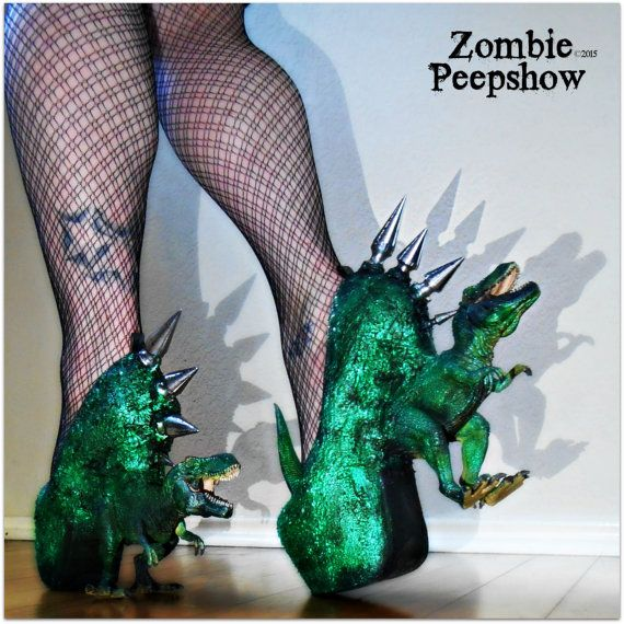These ZombiePeepshow Jurassic Pump platform dinosaur heels are hand painted and textured. Each shoe features mounted T-Rex statues, multiple sized