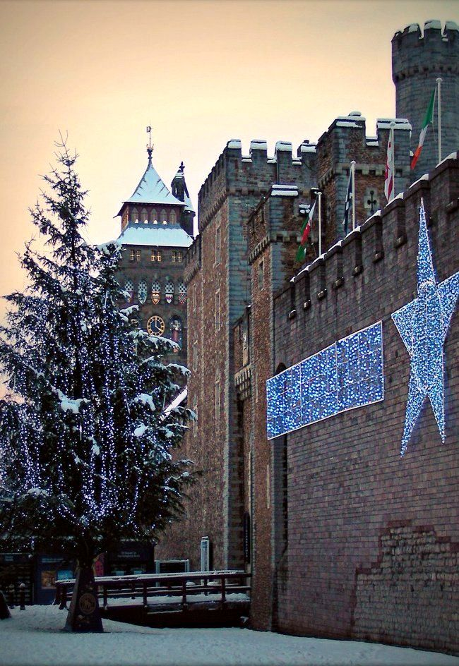 Cardiff Castle at Christmas in the snow, Wales (by DJLeekee on Flickr)