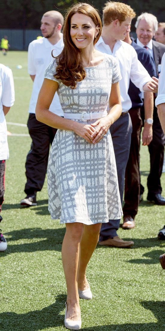 Catherine Middleton got into the Olympic spirit in a belted Hobbs dress and wedges at Bacons College in East London.