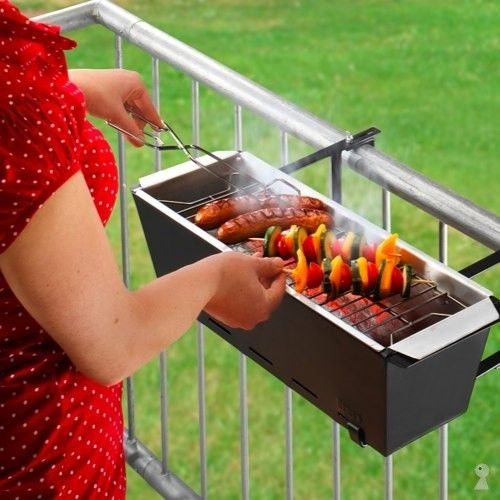 Tiny grill ... perfect for apartment or condo living!  if you are handy & inventive, you could easily make one - ie a planter box, some grates & a bag of Kingsford Charcoal...cool!!
