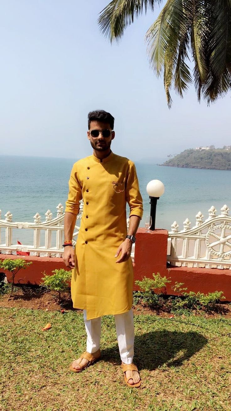 This mustard side button asymmetric kurta is perfect for summer wedding functions. Contact us on +91 7289895895 or mail us at info.baawre@gma… | Kurtas | Pinte…