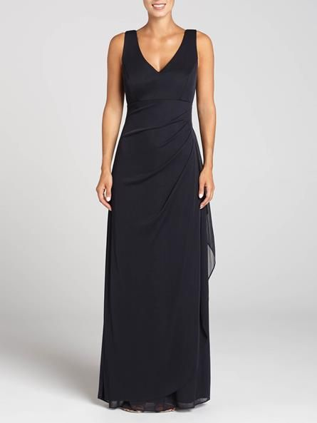 This gorgeous navy gown is both stunning and extremely flattering. The empire cut and ruching on the side and back make this gown unique, while the chunky beading on the neckline adds a nice touch of shine....3030103-0698