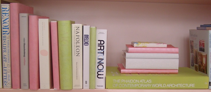Pink and green books on pink bookshelves!  Pastel genius!