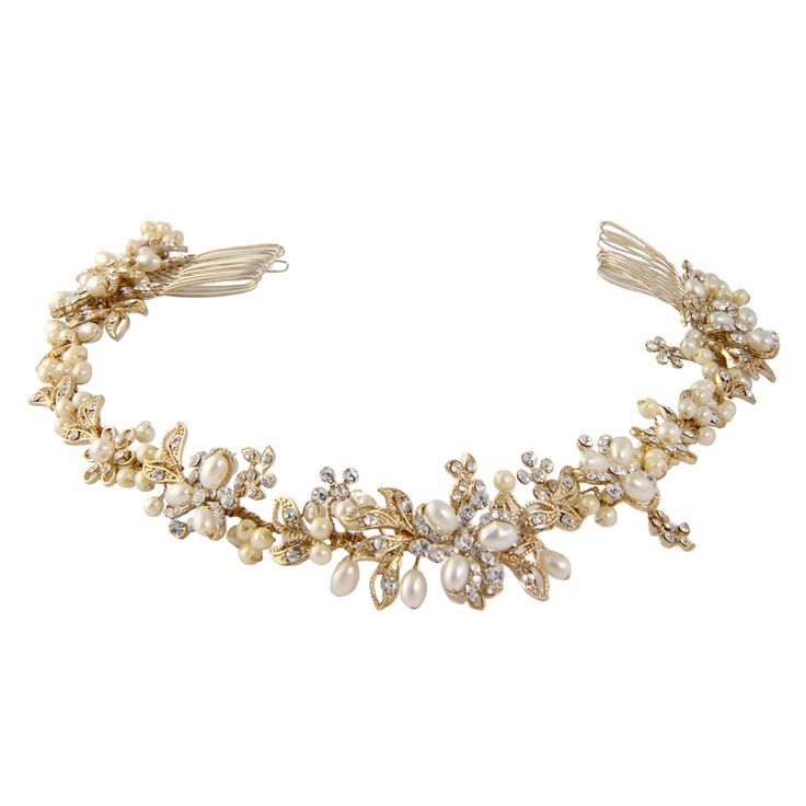 The Brielle Bridal Hair Vine Gold is set in rhodium plating which is tarnish resistant. The beautiful bridal head piece is soft and bendable and can be worn at the front as a forehead halo, or at the back of the head or on a side. It is finished with ivory pearls and clear diamonte in a filigree setting.Measurement: 38cm long with two combs, one on either end.Presented in Roman