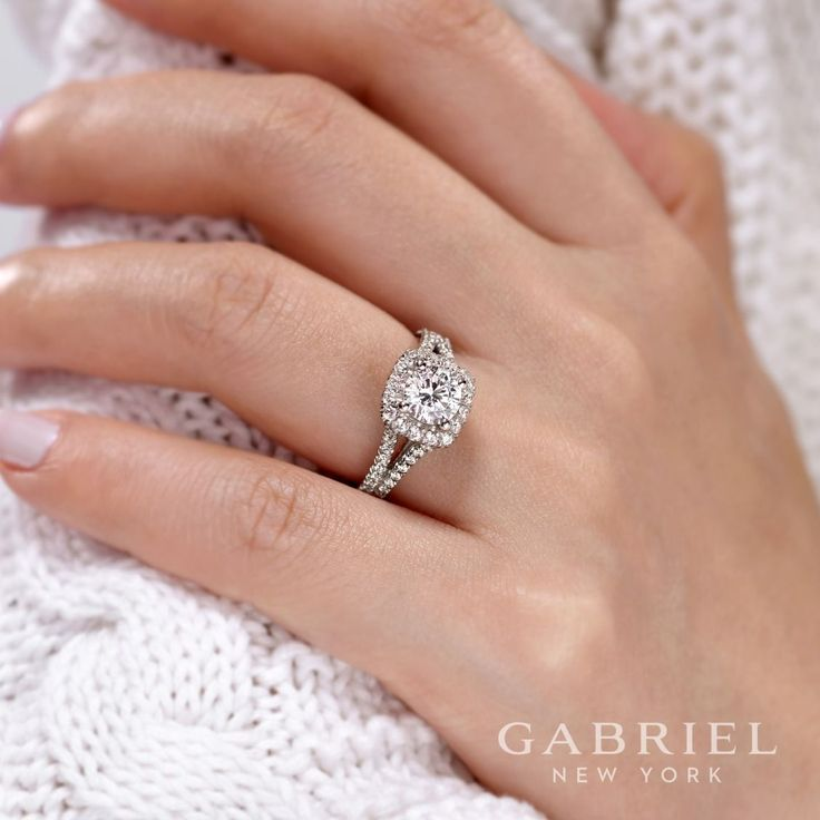 Gabriel NY - Preferred Fine Jewelry and Bridal Brand. 14k White Gold Round Halo  Engagement Ring. Two rows of pave diamonds sparkle along the split shank band of this white gold engagement ring, rising to meet a softened square halo of diamonds in this chic, timeless design. Find your nearest retailer-> https://www.gabrielny.com/storelocator