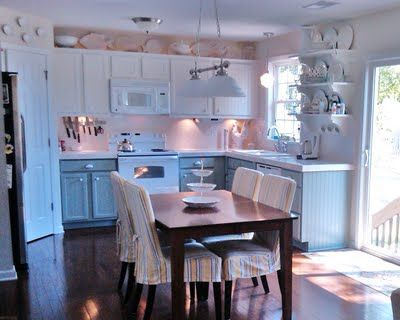 Painting Oak Cabinets White and Gray - Remodelaholic | Remodelaholic..LOVE the milk glass pulls!