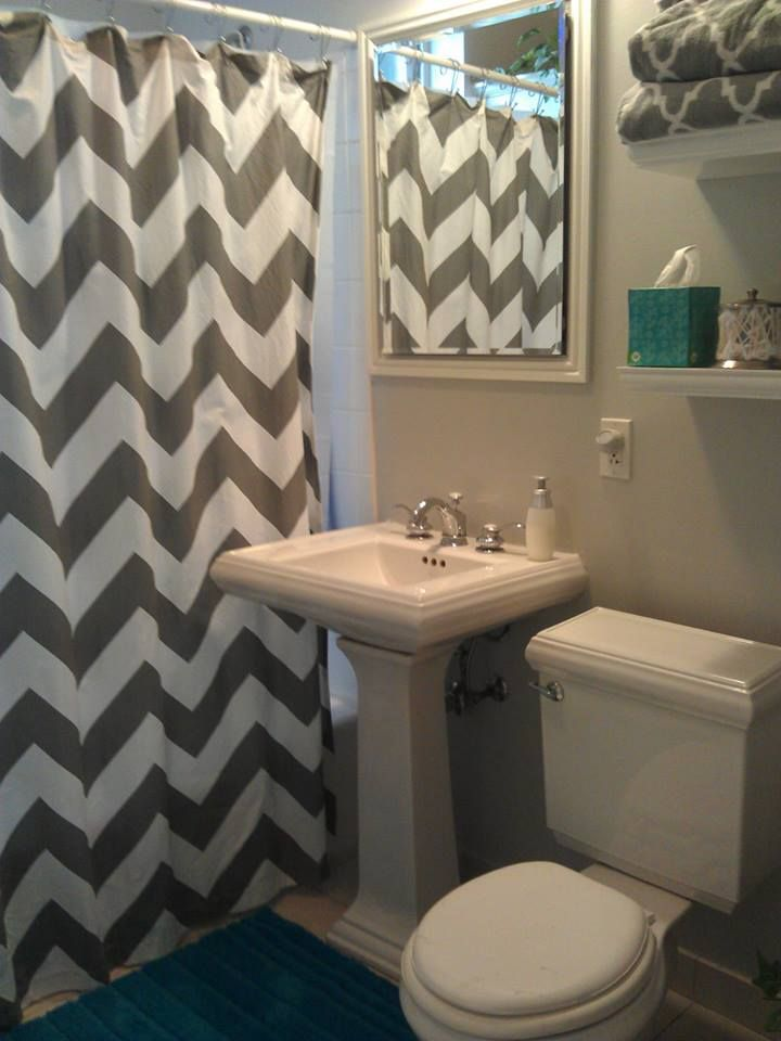 "Updated my bathroom! West Elm gray Chevron shower curtain, Sherwin Williams passive paint color, Home Good towels, Puffs Plus tissue box, Home Good Q-tip container, 24"" floating shelves from Home Depot, Marshalls teal bath rug, Softsoap container"