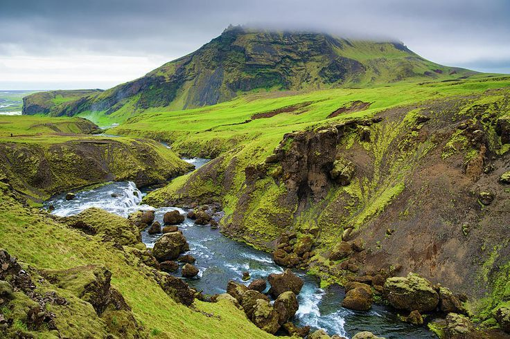 Iceland: River Skoga near Skogafoss and a wonderful green and brown landscape. Available as poster, framed print, metal, acrylic or canvas print. Art for your Home Decor and Interior Design needs by Matthias Hauser.
