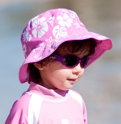 Pink/White Reversible sunhat (only available in Baby (0-2 years) size), $29.99, teamed with Adventure Banz sunglasses in Purple and a Banz long-sleeved rash top - protection-plus!