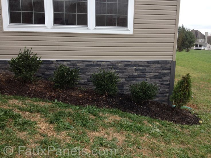 Fake stone foundation covering makes an elegant front garden accent.