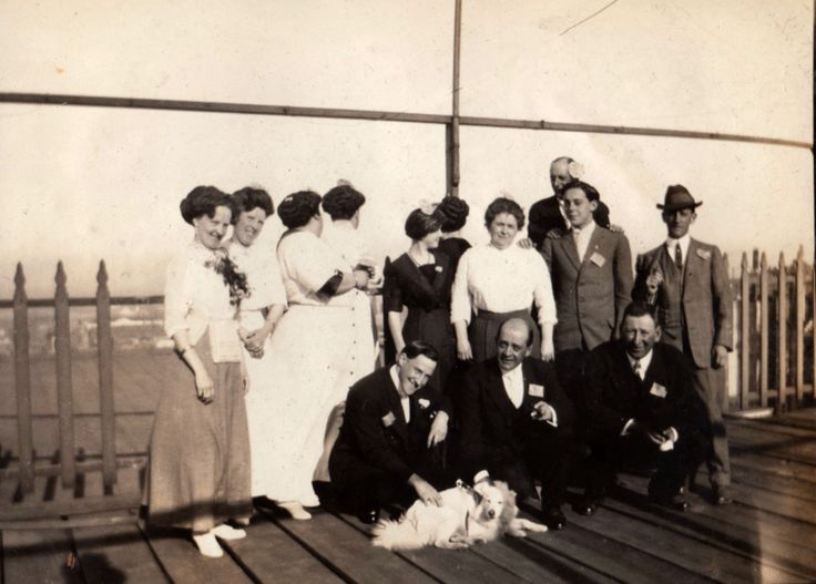 My great grandmother Anna (Ekstrom) Pellegrini (2nd from left) with all of her siblings and siblings spouses, on an outing. My grandmother Louise is center in the black dress. Location unknown. They are wearing American flags in their lapels. I'm not sure who the tall, older man is in the back.
