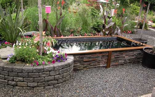 Love the retaining wall of the pond with wood trim pond for Making a koi pond
