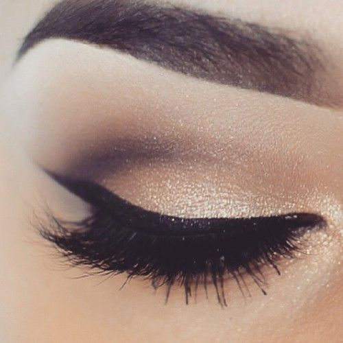 Gold and black smoky eye with winged eyeliner