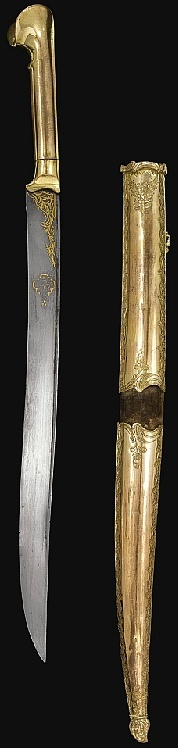AN OTTOMAN TOMBAK SWORD (YATAGHAN) AND SCABBARD, TURKEY, LATE 18TH/EARLY 19TH CENTURY The forward curved steel blade with flat back edge, gold gilt leaf motif at forte with inscription cartouche on one side of blade, the gilt copper hilt with fluted pommel, the fabric covered wooden scabbard with chased engravings on gilt copper with ensuite chape and lock and bud finial. inscriptions Owner's name as: 'al-Hajj Sulayman Agha'