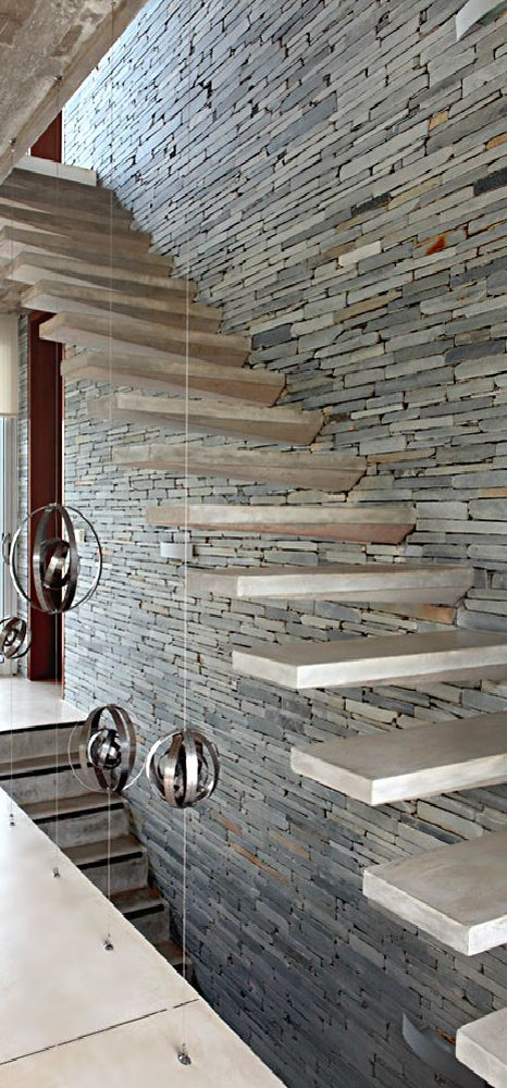 stack stone next to cantilevered stairs - Google Search