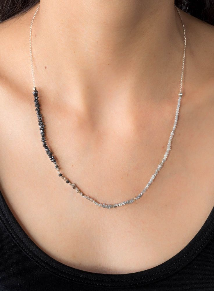 This limited edition necklace features an 8 inch strand of small rough diamond beads that transition in color from white to champagne, to black. The beads are attached to a sterling silver cable chain with a handmade toggle clasp for a total necklace length of 20 inches.