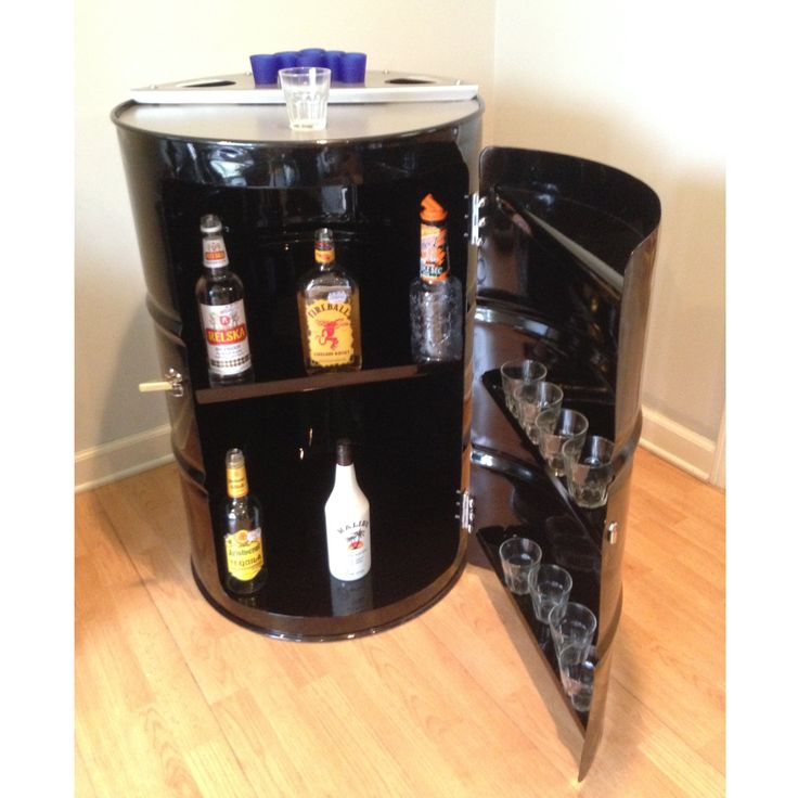 Drum Barrel Furniture The popular Corner Bar is made from a recycled and repurposed steel drum and is sure to be a hit at your next get together! This bar enables you to have a bar in a small space in