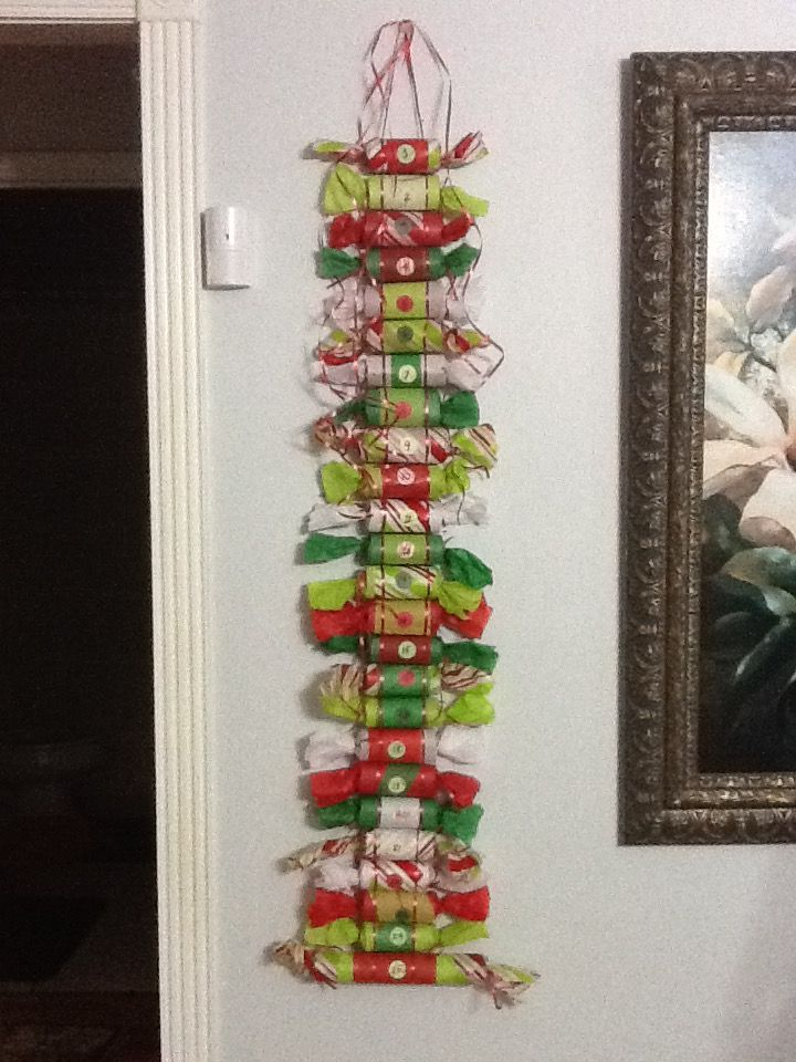 Nailed It!! Made this Christmas advent calendar with TP rolls, tissue paper, ribbon, and goodies! The kids love it!
