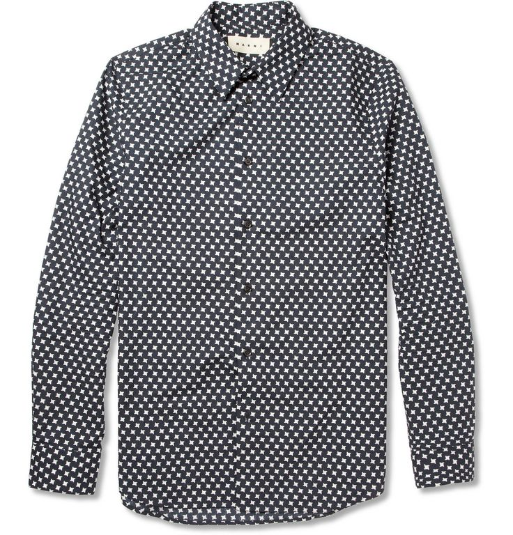A printed shirt is a must have and this Marni shirt in a traditional black and white houndstooth check ticks all the right boxes. Wear it with a monochrome jumper and dress pants for a sophisticated look.