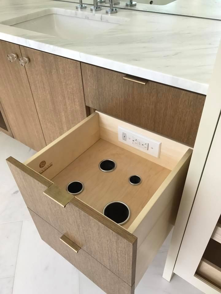 Clutter Free Organized Spaces With In Drawer Electrical Outlets From Docking Drawer Remodelista Bathroom Drawers Bathroom Storage Solutions Small Bathroom Storage