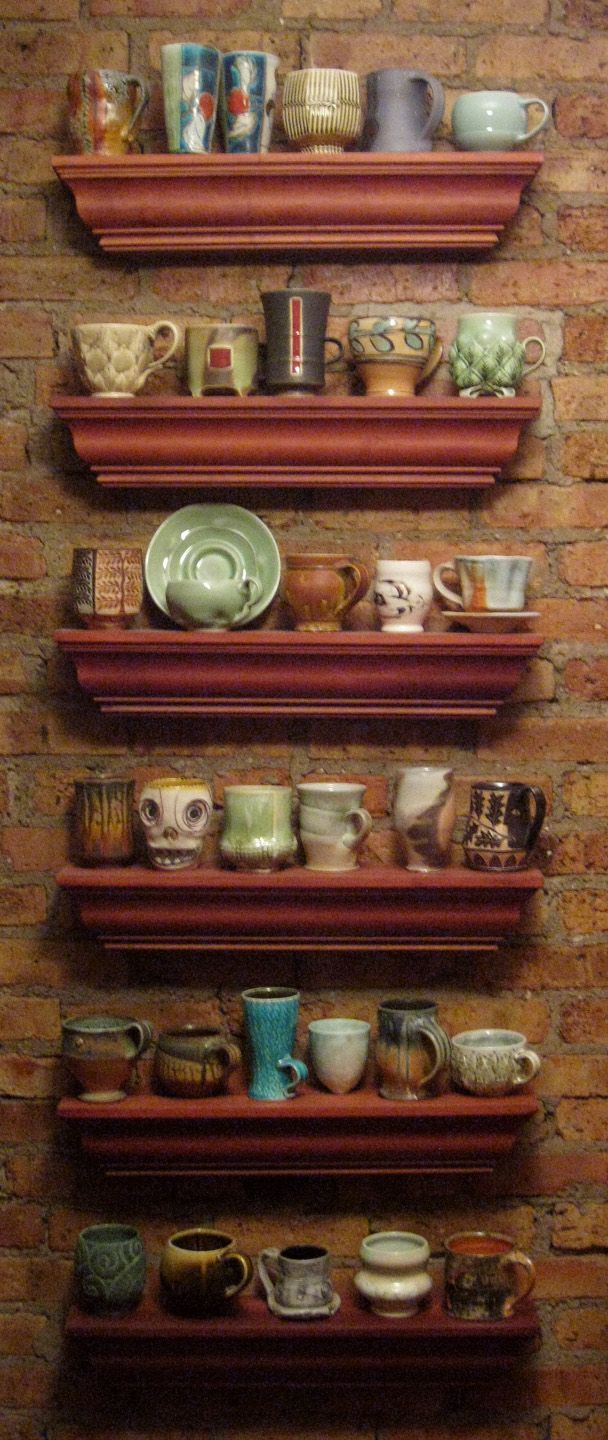 Look at all the inspiration... im going to have to try and recreate some of these myself!  Gary Jackson's personal mug collection displayed in his kitchen.