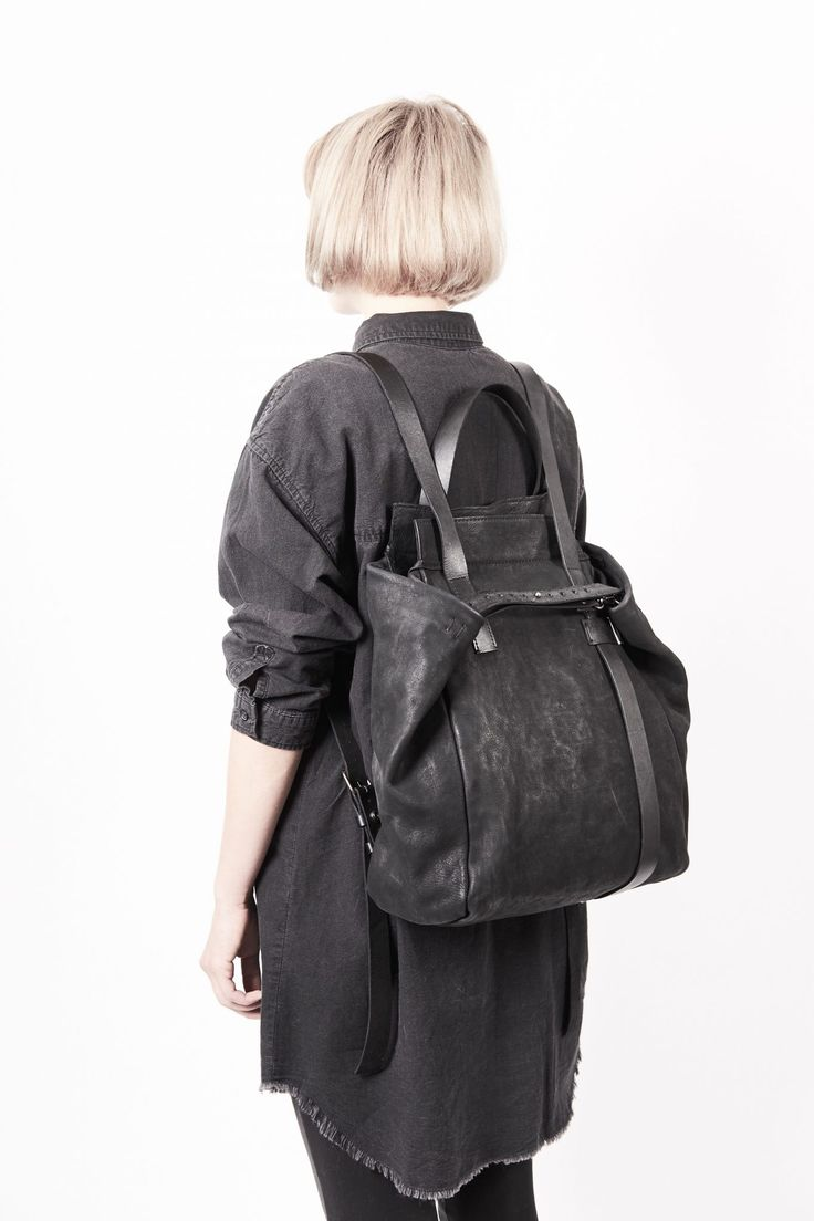 Backpack-tote bag 020Y - black – by independent designer ytn7, €598 at Vathir.com   Large washed leather rucksack-tote bag - Large main compartment lined with an off black cotton - Two interior pockets  one with a zipper closure and with open top. - Decorative melchior element - Belt leather handles can be worn as a backpack - Zipper closure to the main compartment - Detachable...