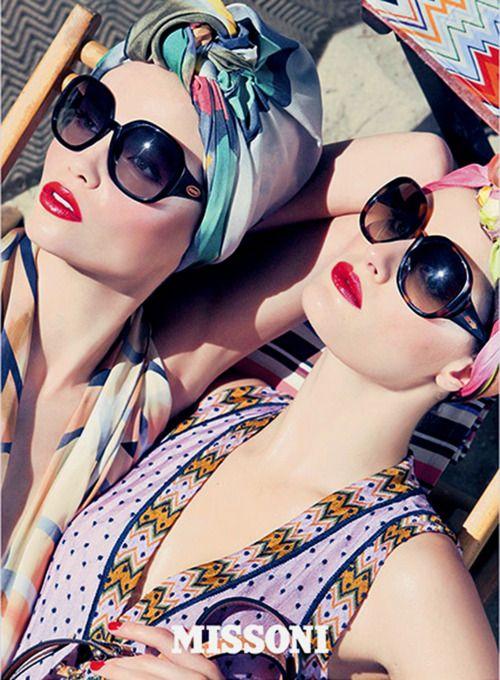 Turban, round sunglasses, prints and red lippie.