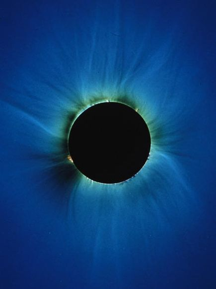 Total solar eclipse. The atmospheric effects resemble an iris surrounding a very dilated pupil.