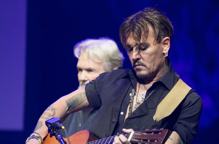 LOS ANGELES, CA - OCTOBER 23: Johnny Depp performs at Vidiots Foundation Presents The Harry Dean Stanton Award at The Theatre at Ace Hotel on October 23, 2016 in Los Angeles, California. (Photo by Gabriel Olsen/Getty Images)