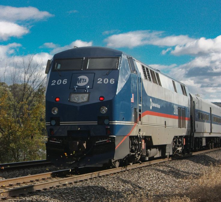 The Dual Mode P32AC-DM is unique not only because of its third-rail capability, but also because it is equipped with GE's GEB15 AC (alternating current) traction motors, rather than DC (direct current) motors as used in the other subtypes. The model is confined to services operating from New York City, where diesel emissions through its two fully enclosed main terminal stations are prohibited. P32AC-DMs are seen only on Amtrak's Empire Corridor between Penn Station and Buffalo, the Ethan…
