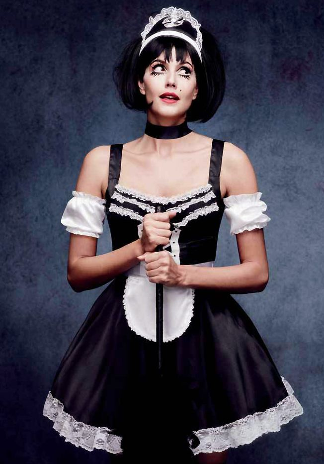 Our Flirty French Maid Halloween costume features black satin dress with white lace ruffle trim and white satin apron. Also includes puff sleeves and maid hat headband. Father duster is not included.