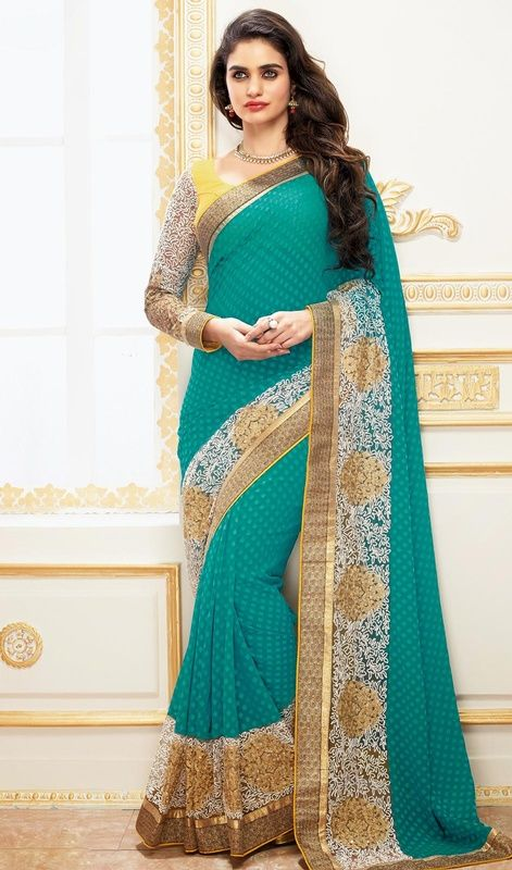 Add A Small Burst Of Shade To The Wardrobe With This Greenish Blue Faux Georgette Saree. The Wonderful Jaal Work, Resham,Stones Work A Significant Feature Of This Attire. #EarthlyBlueGeorgetteSariCollection