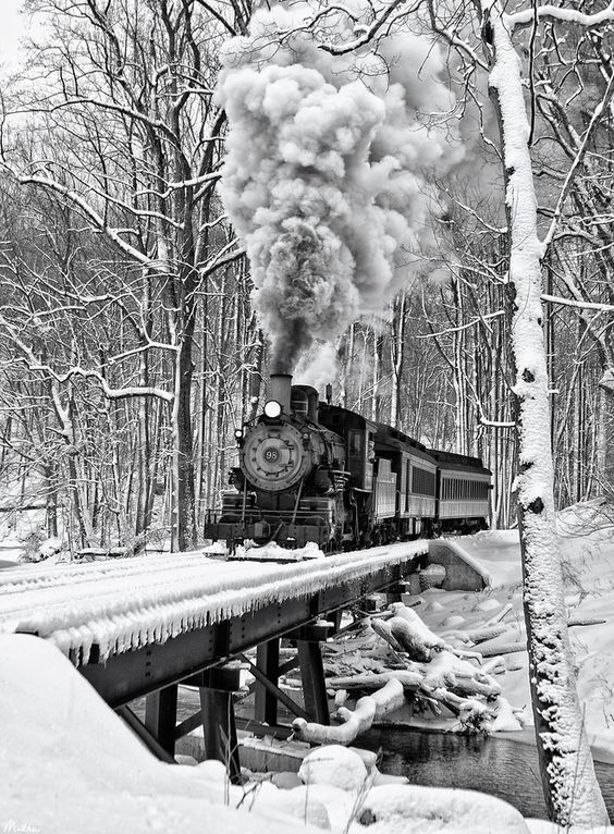 Winter....steam locomotive on the bridge enters
