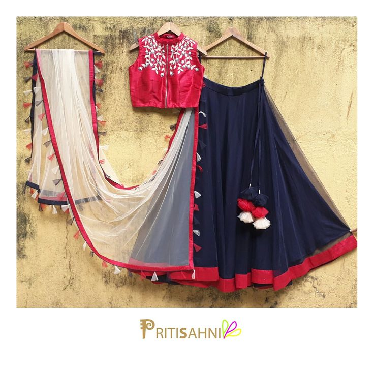 Twirling with tasselsPlay your cool chic card in this navy blue skirt with crimson raw silk embroidered crop top and dupatta with colorful tassels .For more information Whatsapp on +91-9022617481. 27 September 2017