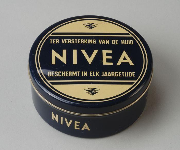 """Zalfblik """"Nivea, ter verzorging van de huid, beschermt in elk jaargetijde"""" - 1970-1975"""