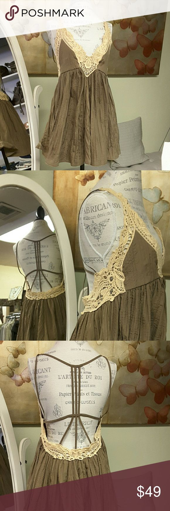 Free People top/tank/tunic Oversized top with strappy detail at back. Cream crochet and olive polyester fabric. Size xs, could be worn up to a size med approx. Gently worn. Free People Tops