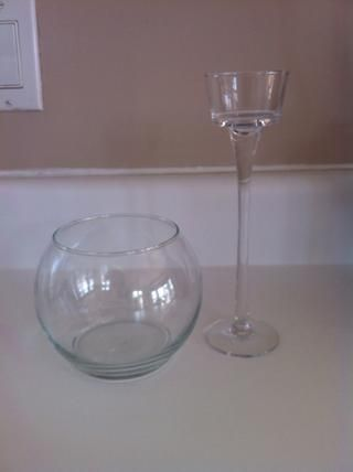 First purchase a small glass fish bowl vase and a tall glass candle holder ( I got mine at a local dollar store).