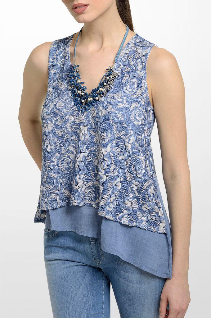 Sarah Lawrence - asymmetrical sleeveless double layered top, straight leg denim pant, beaded necklace.