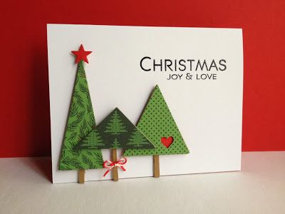 handmade Christmas card from I'm in Haven ... luv this variation of the triangle tree ... sweet little heart negative space ... super mod look ...